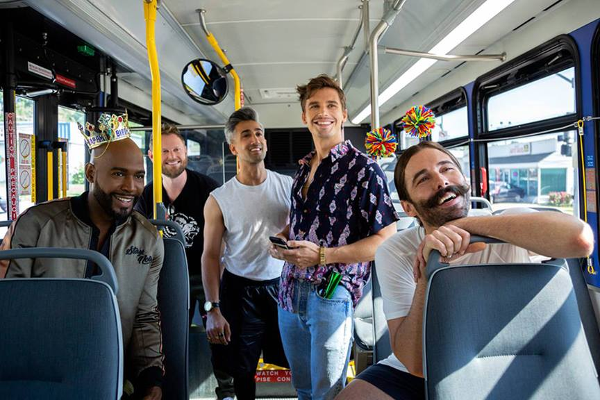five men smiling on bus queer eye
