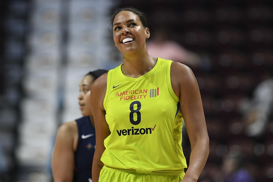 Liz Cambage woman on basketball court smiling