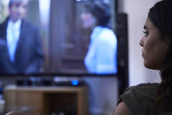 Upset girl watching televsion